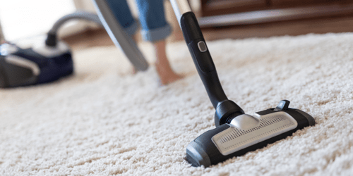 Rug cleaning by vaccum cleaner | Johnston Paint & Decorating